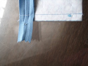 Reinforced stitching over the zipper teeth